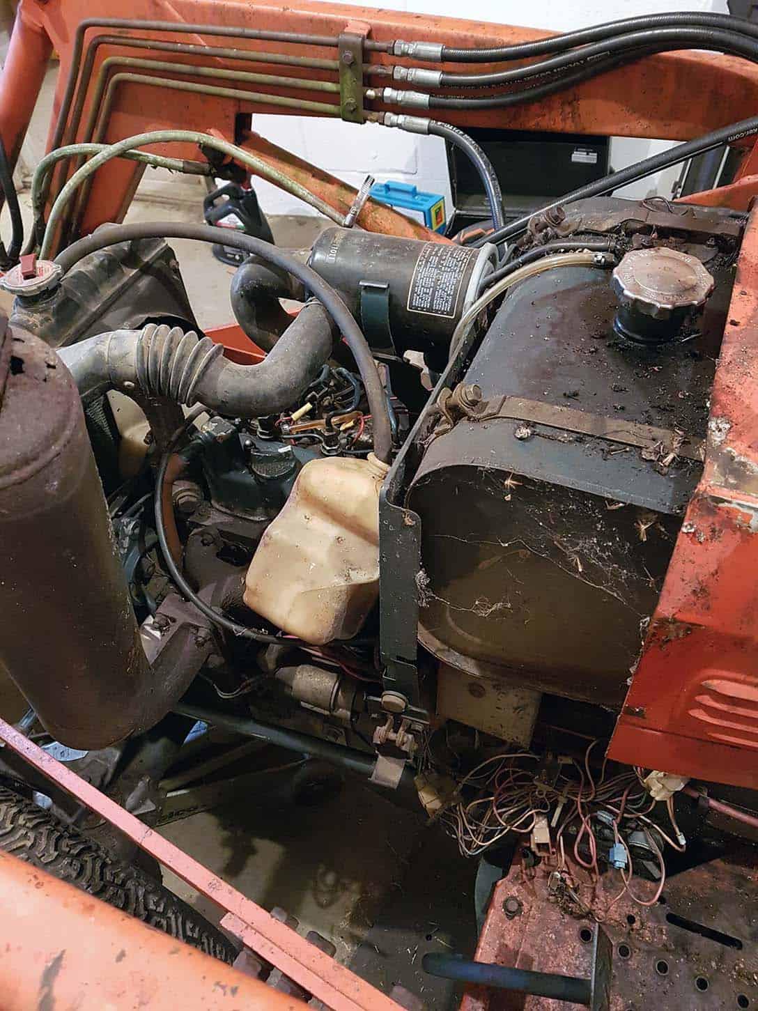 Kubota B20 weathered engine compartment.